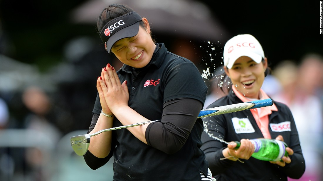 Ariya Jutanugarn, left, celebrates victory at the Women's British Open on Sunday, July 31. Jutanugarn, 20, is the first Thai golfer to ever win a major.