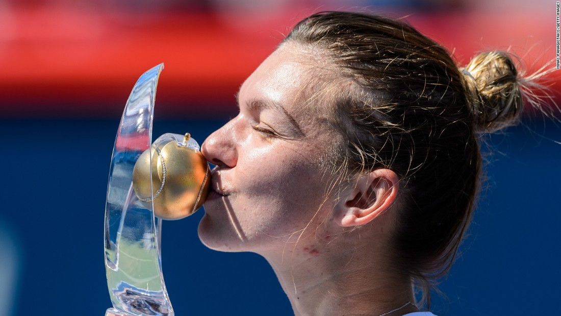 Simona Halep kisses her trophy after winning the Rogers Cup in Montreal on Sunday, July 31. She defeated Madison Keys in the final.