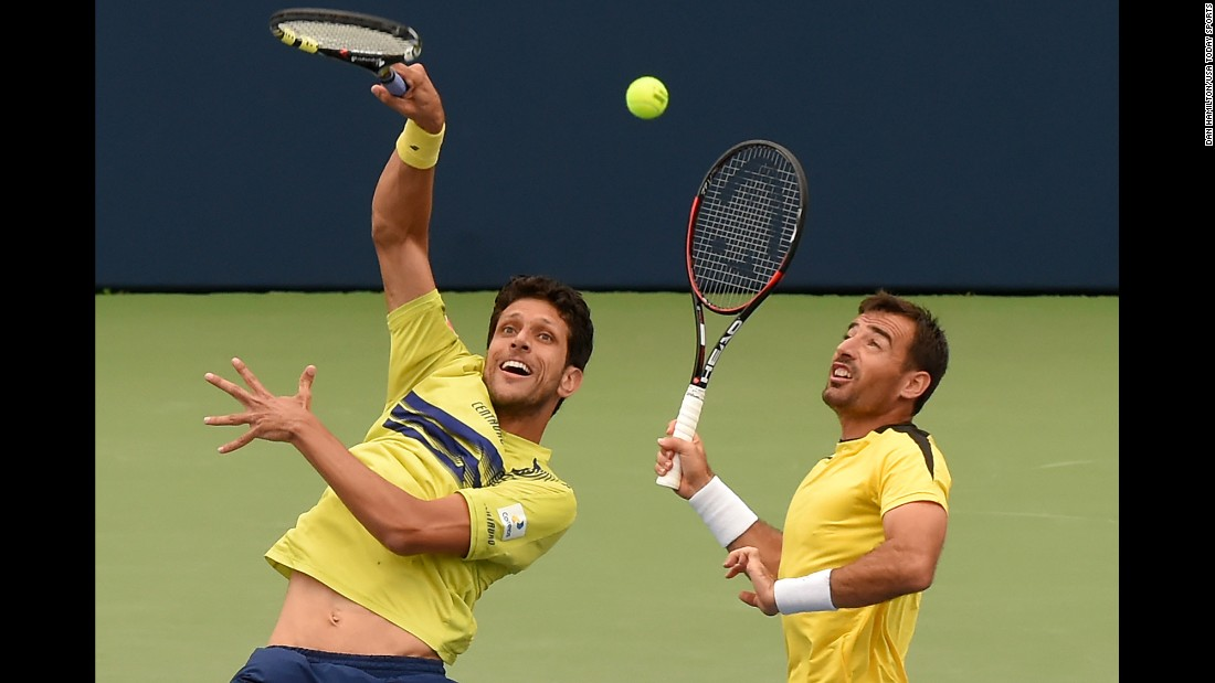 Marcelo Melo hits a shot next to his doubles partner, Ivan Dodig, during the Rogers Cup final in Toronto on Sunday, July 31. Melo and Dodig won in straight sets over Jamie Murray and Bruno Soares.