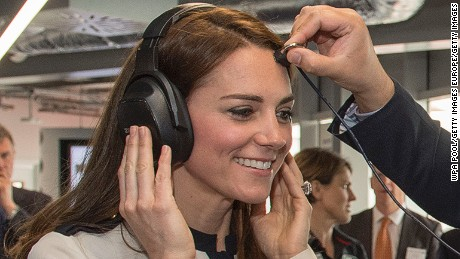 PORTSMOUTH, ENGLAND - MAY 20:  Mohammed-Asif Akhmad from BAE Systems places a microphone on Catherine, Duchess of Cambridge, patron of the 1851 Trust, as she tours the new 'Tech Deck' Education Centre during her visit to the Land Rover BAR team, who are challenging for the 2017 America's Cup, on May 20, 2016 in Portsmouth, England. The Duchess of Cambridge is launching the 1851 Trust's two sailing projects and meeting people involved in the project. Afterwards she will open the 'Tech Deck' Education Centre at the heart of the base.  (Photo by Arthur Edwards-WPA Pool/Getty Images)
