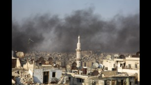 A thick smogs hangs over Aleppo as residents light fires to prevent pilots from bombing their homes.