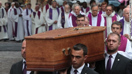 Pallbearers carry the coffin of the priest Jacques Hamel as they enter in Rouen's cathedral on August 2, 2016 during the funeral of the priest who was killed in a church in Saint-Etienne-du-Rouvray on July 26 during a hostage-taking claimed by Islamic State group.