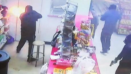 Cashier survives grocery store shootout pkg_00000000