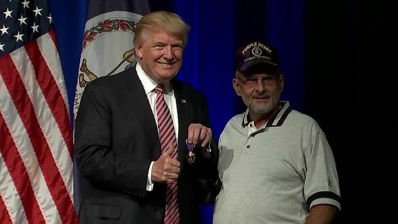 Donald Trump receives Purple Heart from veteran