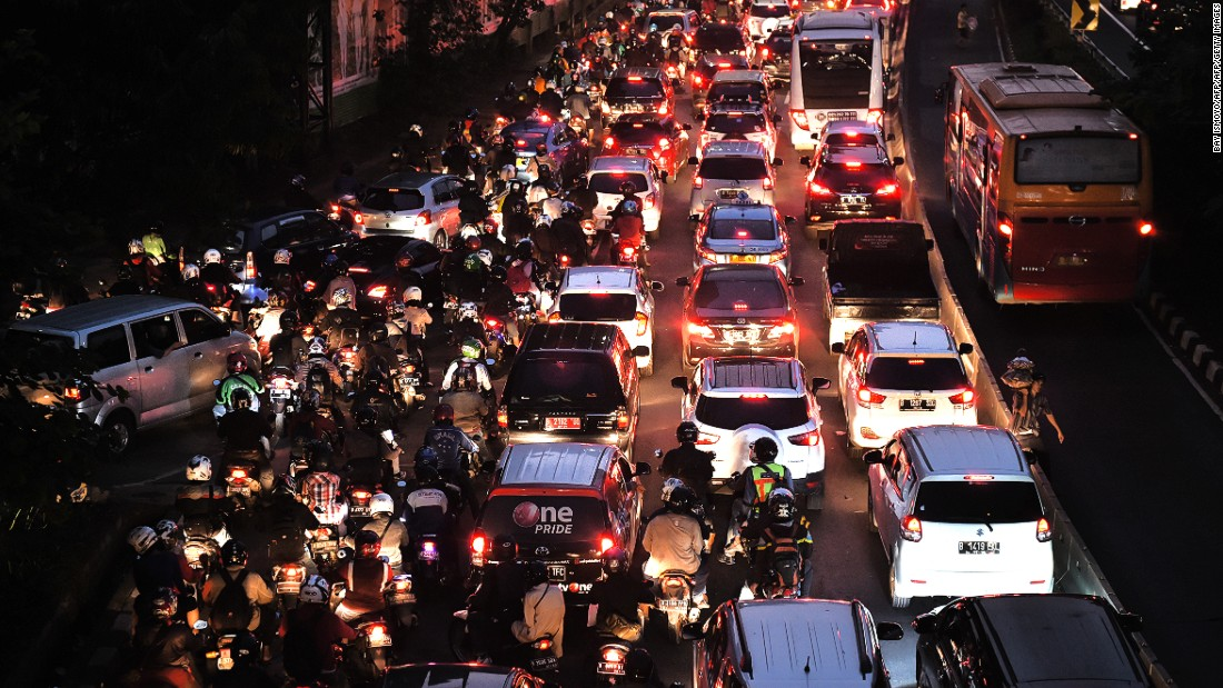 Motorists in a traffic jam on a main road in Jakarta on June 21, 2016.