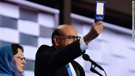 Khizr Khan (R), accompanied by his wife Ghazala Khan (L), holds up a copy of the US Constitution as he speaks about their son US Army Captain Humayun Khan who was killed by a suicide bomber in Iraq 12 years ago, on the final night of the Democratic National Convention at the Wells Fargo Center, July 28, 2016 in Philadelphia, Pennsylvania.
