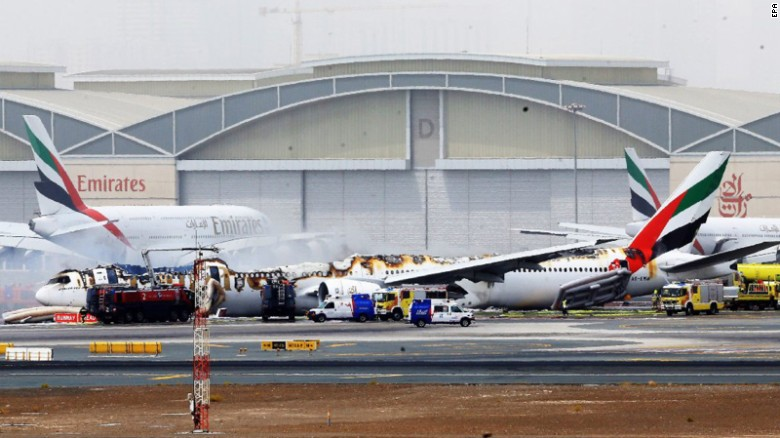 The burnt plane sits on a tarmac with part of the fuselage missing.