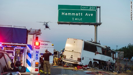 Rescue crews respond to the scene of a charter bus crash on northbound Highway 99 between Atwater and Livingston, California on Tuesday, August. 2. The bus veered off the central California freeway before dawn Tuesday and struck a pole that sliced the vehicle nearly in half, authorities said.