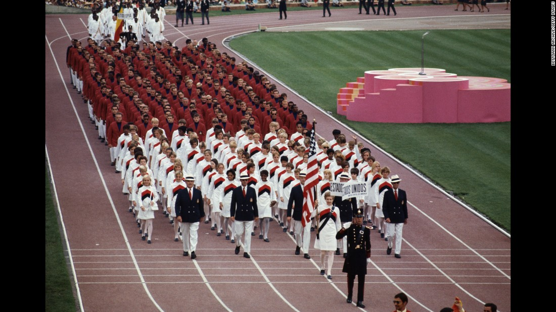 <strong>Mexico, 1968:</strong> Listen, this seriously needs to happen. There really needs to be an Olympic throwback collection, and these white dress/sweater things need to be in it. We'll pass on the men's navy turtlenecks, though.