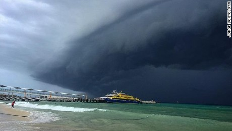 A perfect beach day was halted as ominous dark clouds from Hurricane Earl have made their way to Playa del Carmen, Mexico.