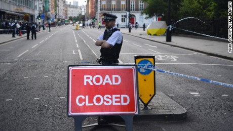 A police officer guards the scene of the knife attack Thursday at Russell Square in London.