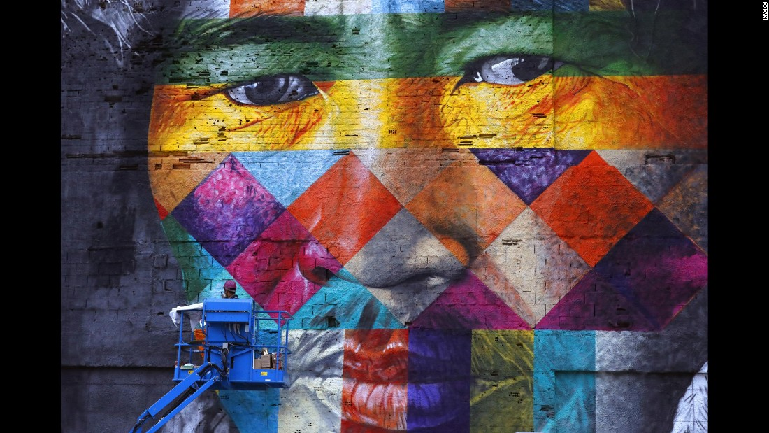 A giant mural created by Brazilian artist Eduardo Kobra is on display in Rio on Friday, July 22.