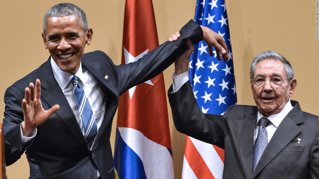 "Cuban President Raul Castro tries to lift up Obama's arm at the end of a joint news conference in Havana, Cuba, in March 2016. Castro hailed Obama's opposition to a long-standing economic ""blockade,"" but said it would need to end before ties between the two countries are fully normalized."