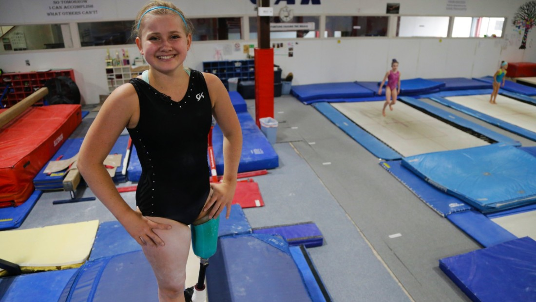 Now she competes against able-bodied gymnasts on bars and beam.