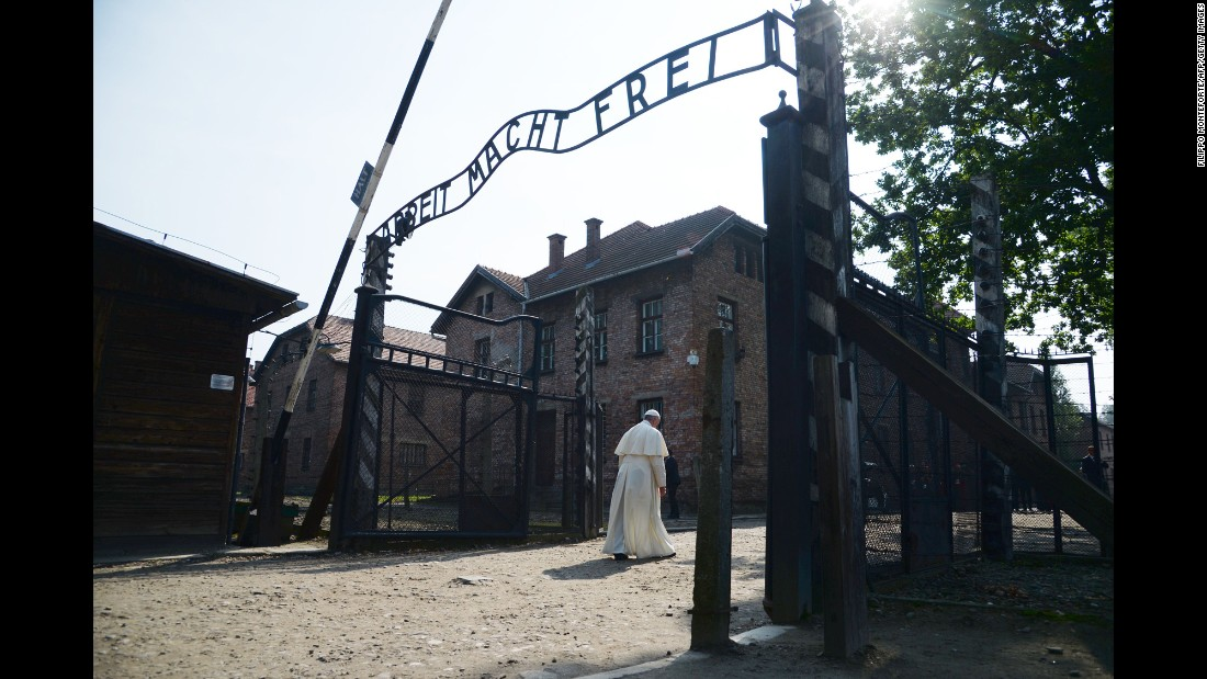 "Pope Francis passes the main entrance to Auschwitz-Birkenau, the former concentration camp in Poland, on Friday, July 29. The Pope <a href=""http://www.cnn.com/2016/07/29/europe/poland-pope-auschwitz-visit/"" target=""_blank"">was there to pay tribute</a> to those who lost their lives during the Holocaust."