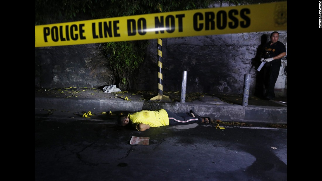 "A crime-scene investigator works near the body of a suspected drug dealer who was fatally shot in Pasay City, Philippines, on Thursday, August 4. New President Rodrigo Duterte campaigned hard on <a href=""http://www.cnn.com/2016/08/03/asia/philippines-war-on-drugs/"" target=""_blank"">a no-nonsense approach to crime,</a> and on several occasions he has hinted openly that he doesn't oppose his police force or even citizens taking the lives of suspected criminals. Philippines police say at least 239 drug suspects were killed in the three weeks after Duterte's inauguration. Critics see the approach as a complete disregard of due process."