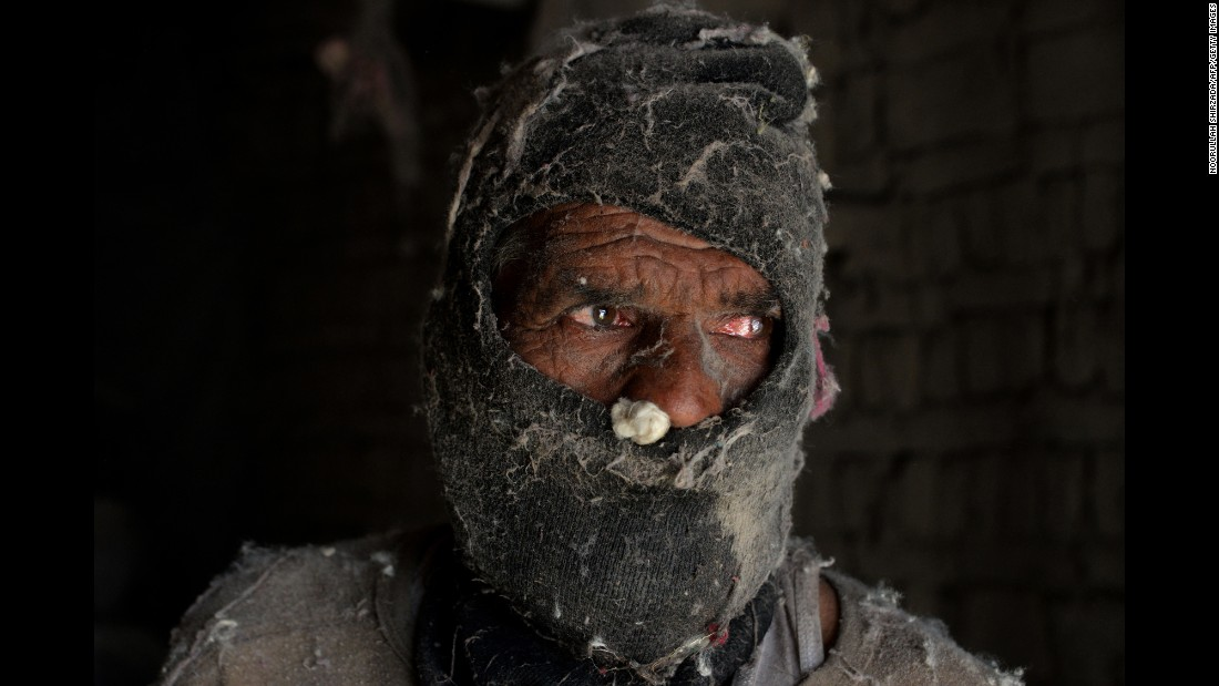 A laborer works at a cotton factory in Jalalabad, Afghanistan, on Sunday, July 31.