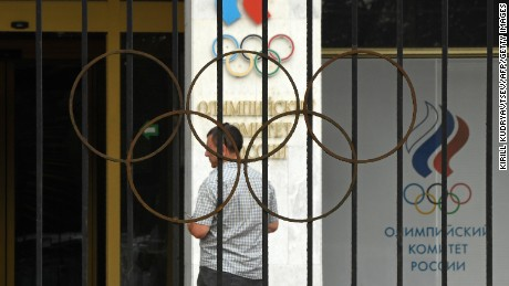 """A man walks in front of the Russian Olympic Committee (ROC) building in Moscow on July 25, 2016. Russia breathed a sigh of relief after the IOC declined to impose a blanket ban on its competitors at the Rio Games over state-run doping, but the decision met fierce criticism elsewhere with Olympic chiefs branded """"spineless"""". In one of the most momentous moves in its chequered history, the International Olympic Committee said on July 24, 2016, it was up to each international sports federation to decide if Russians could take part in Rio. The federations now face a race against the clock with the opening ceremony only 11 days away, global sport sharply divided and some Russian competitors already in Brazil. / AFP / Kirill KUDRYAVTSEV        (Photo credit should read KIRILL KUDRYAVTSEV/AFP/Getty Images)"""