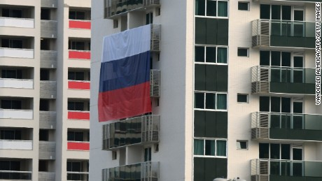 "A Russian flag is displayed at the Rio 2016 Olympic Village for Athletes, on July 25, 2016 in Rio de Janeiro.  Russia breathed a sigh of relief after the IOC declined to impose a blanket ban on its competitors at the Rio Games over state-run doping, but the decision met fierce criticism elsewhere with Olympic chiefs branded ""spineless"".  / AFP / VANDERLEI ALMEIDA        (Photo credit should read VANDERLEI ALMEIDA/AFP/Getty Images)"