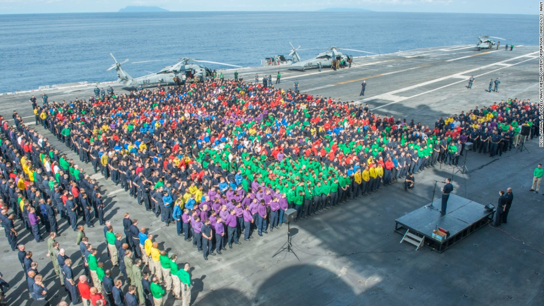 Capt. Buzz Donnelly, commanding officer of the USS Ronald Reagan addresses the crew during an all-hands call in July 2016. A Nimitz-class aircraft carrier like the USS Ronald Reagan carries about 5,700 sailors and air crew.