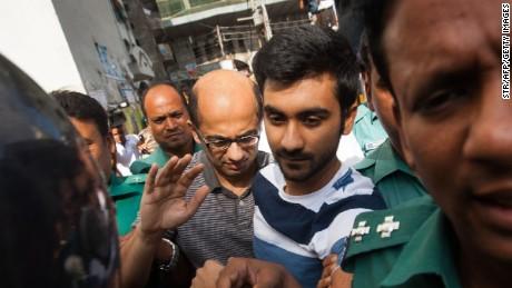 Bangladesh police escort Hasnat Karim (center-left) and Tahmid Hasib (center-right) toward court on August 4, 2016.