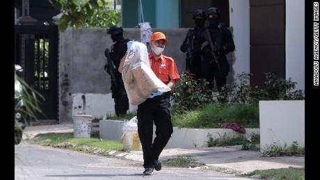 Anti-terror police conduct a raid Friday on the Indonesian island of Batam.