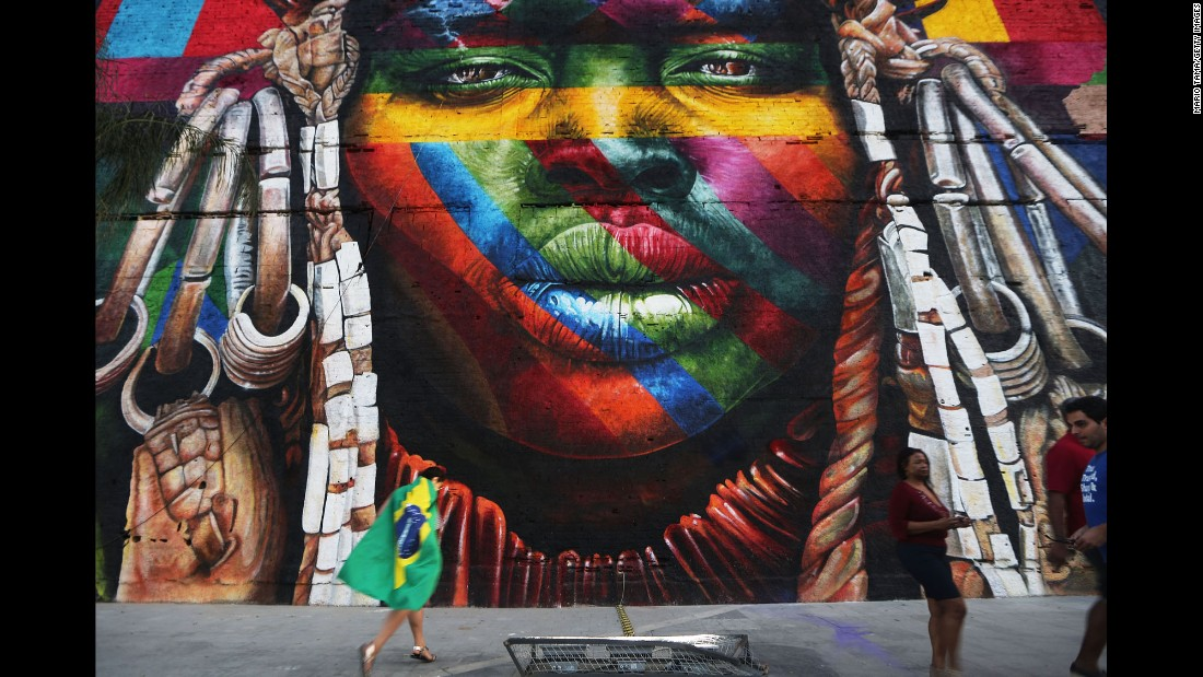 """A mural depicts an indigenous face created by Brazilian graffiti artist Eduardo Kobra and assistants on August 4. The 32,000-square-foot """"We Are All One"""" celebrates cultural diversity."""