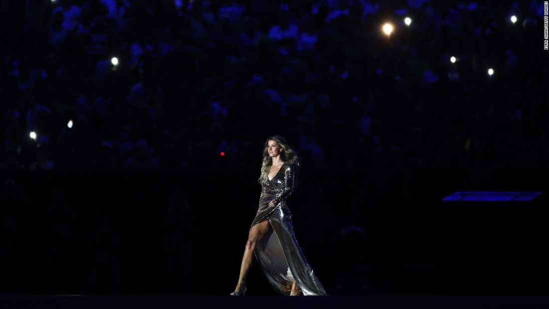 Brazilian supermodel Gisele Bundchen walks on stage at the start of the event.