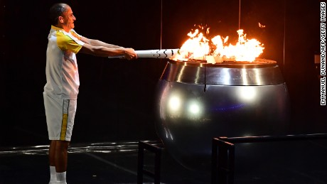 Former Brazilian athlete Vanderlei Cordeiro lights the Olympic cauldron with the Olympic torch during the opening ceremony of the Rio 2016 Olympic Games at Maracana Stadium in Rio de Janeiro on August 5, 2016.