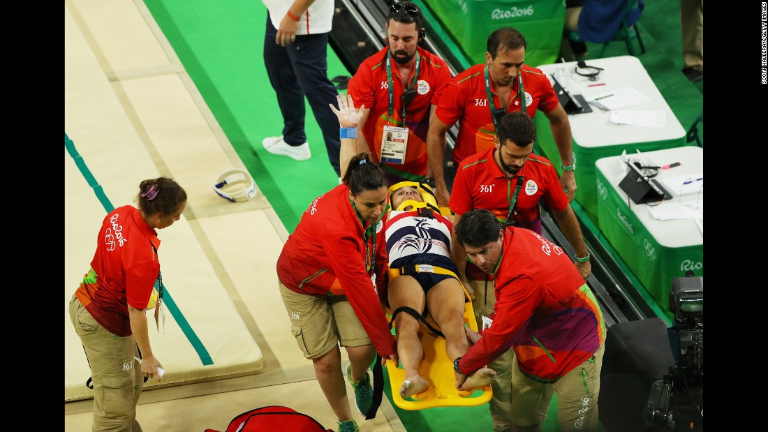 French gymnast Samir Ait Said receives medical attention after breaking his leg while competing on the vault during the artistic gymnastics men's team qualification round.