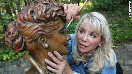 Artist Carolyn Palmer applies the finishing touches to the new statue of Lucille Ball.