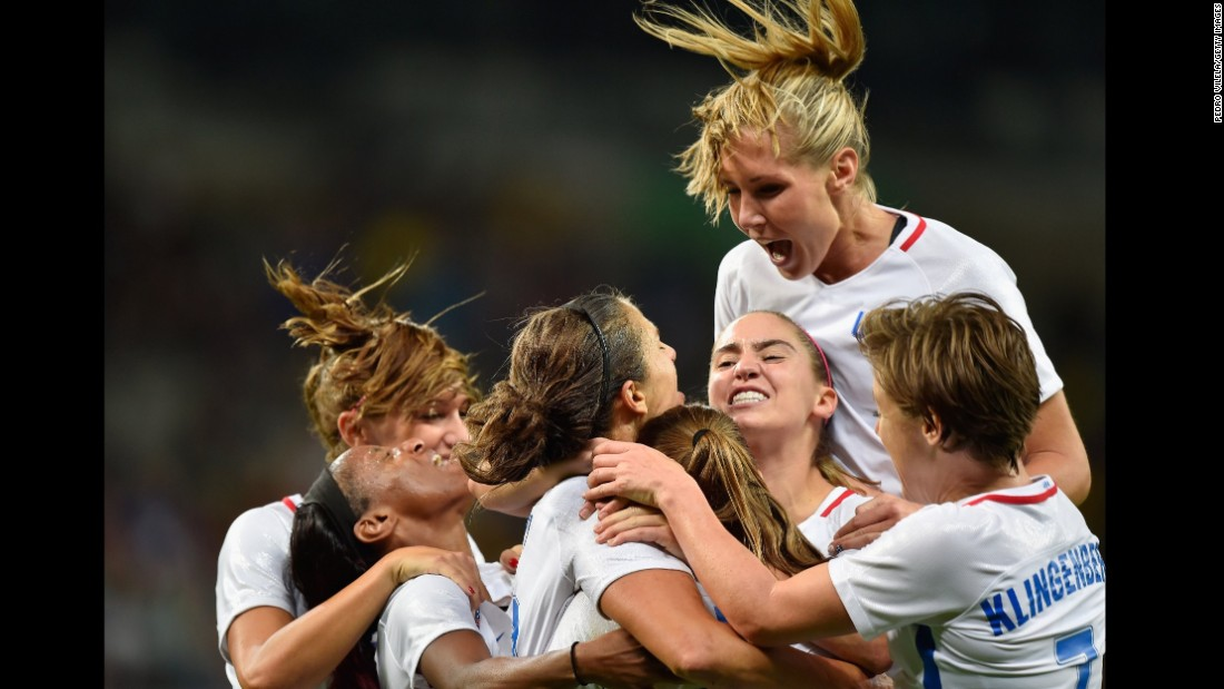 Carli Lloyd of United States celebrates with her team after scoring during the women's Group G first round match between United States and France. The United States won the match 1-0.