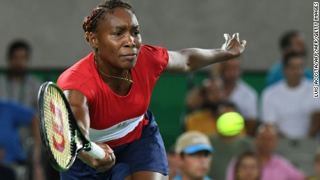 Venus Williams returns the ball to Kirsten Flipkens.