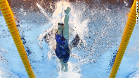 Katie Ledecky, center, competes in a heat of the women's 400-meter freestyle during the swimming competitions.