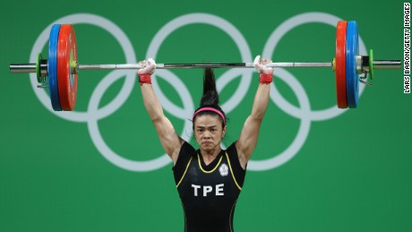 Shu-Ching Hsu of Chinese Taipei competes during the Women's 53kg  weightlifting contest