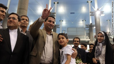 Amiri initially returned to Iran to a hero's welcome