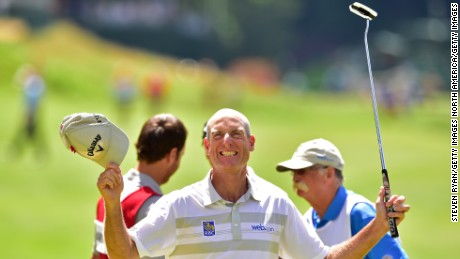 Jim Furyk celebrates his record-breaking round at the Travelers Championship.