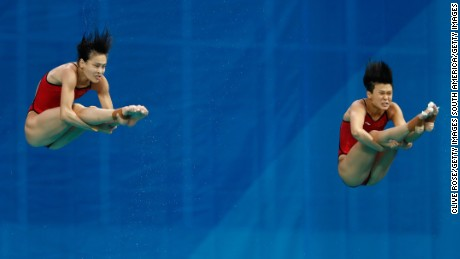 Tingmao Shi and Minxia Wu of China compete in the Women's Diving Synchronised 3m Springboard Final
