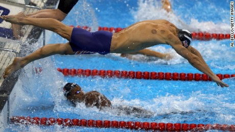 Michael Phelps back has cupping marks, as he competes in the Final of the Men's 4 x 100m Freestyle Relay.