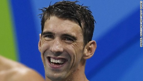 USA's Michael Phelps smiles after team USA won the Men's 4x100m Freestyle Relay Final during the swimming event at the Rio 2016 Olympic Games at the Olympic Aquatics Stadium in Rio de Janeiro on August 7, 2016.   / AFP / GABRIEL BOUYS        (Photo credit should read GABRIEL BOUYS/AFP/Getty Images)