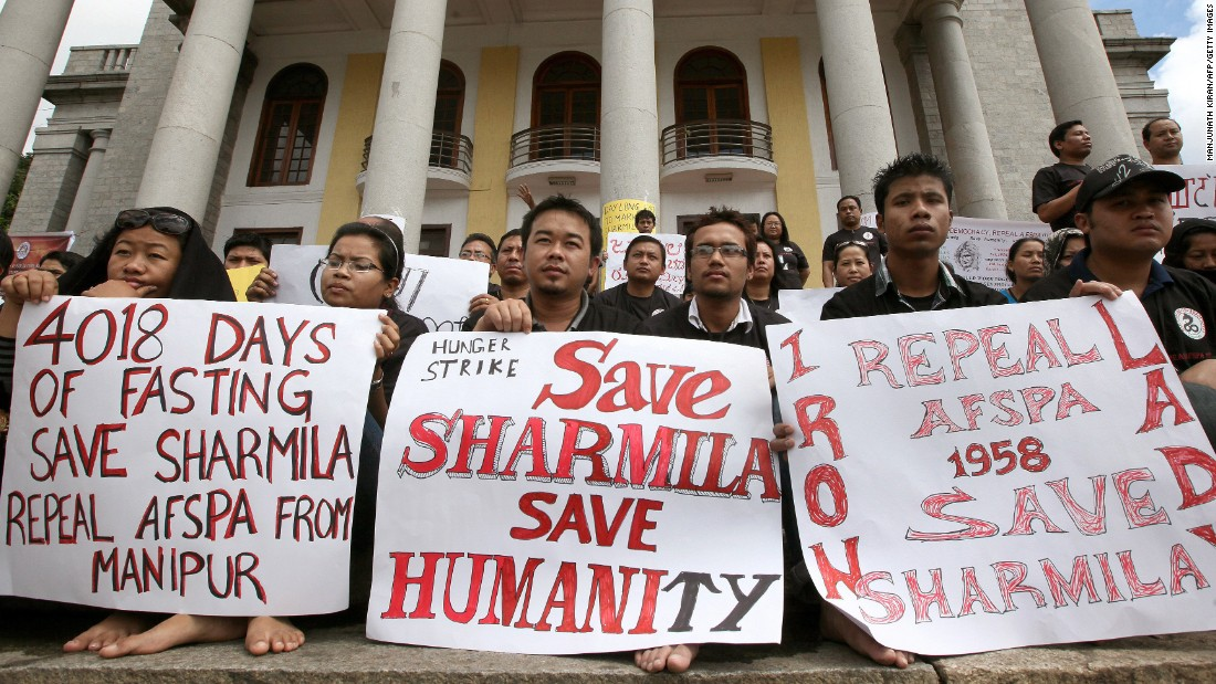 Members of the Bangalore chapter of Manipuri Metei Association hold placards during a silent sit-in protest in support of Irom Sharmila. To prevent her death, Indian authorities force-fed the activist through a plastic drip.