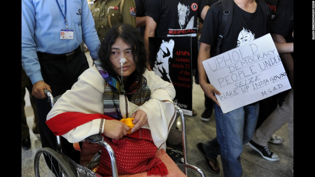 Sharmila arrives at the Indira Gandhi International Airport in New Delhi in March, 2013. The jailed activist was fed through her nose in the security ward of the Jawaharlal Nehru Institute of Medical Sciences hospital in Imphal, under a law that makes attempted suicide illegal.