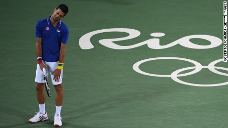 Serbia's Novak Djokovic reacts after losing a point during his men's first round singles tennis match against Argentina's Juan Martin Del Potro at the Olympic Tennis Centre of the Rio 2016 Olympic Games in Rio de Janeiro on August 7, 2016. / AFP / Roberto SCHMIDT        (Photo credit should read ROBERTO SCHMIDT/AFP/Getty Images)