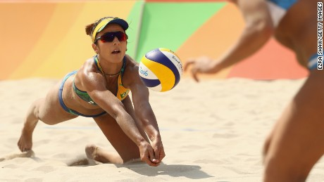 Agatha Bednarczuk of Brazil dives during the Women's Beach Volleyball preliminary round Pool B match against Ana Gallay and Georgina Klug of Argentina on Day 3 of the Rio 2016 Olympic Games at the Beach Volleyball Arena on August 8, 2016 in Rio de Janeiro, Brazil.