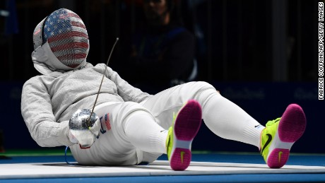 US Ibtihaj Muhammad reacts on the piste as she competes against France's Cecilia Berder during their womens individual sabre qualifying bout as part of the fencing event of the Rio 2016 Olympic Games, on August 8, 2016, at the Carioca Arena 3, in Rio de Janeiro.