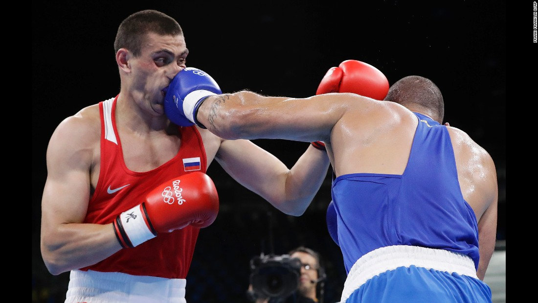 Brazil's Juan Nogueira, right, lost to Russia's Evgeniy Tishchenko in their heavyweight boxing match.
