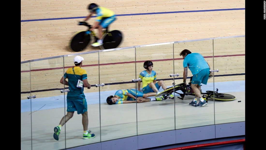 Australian cyclist Melissa Hoskins, center left, lies on the track after the pursuit team crashed during a training session. She was taken to the hospital.