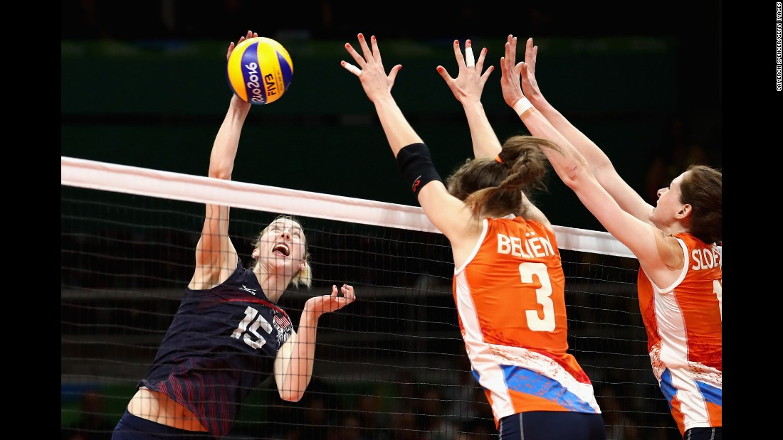U.S. volleyball player Kimberly Hill spikes the ball during a preliminary match against the Netherlands. The United States won 3-2.