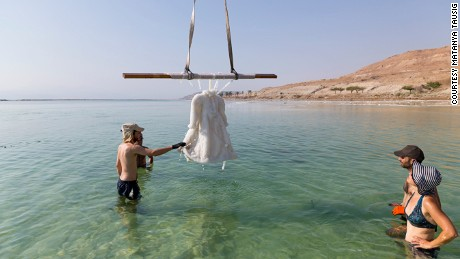 """Studio Landau lifting """"Small Salt Bride"""" from the waters of the Dead Sea"""