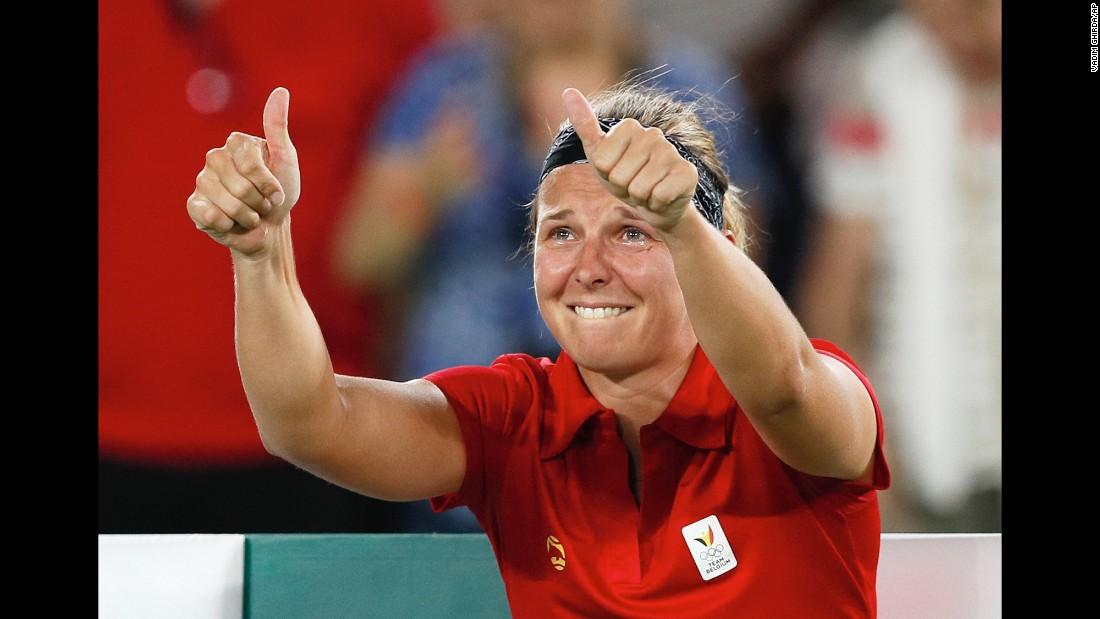 Belgian tennis player Kirsten Flipkens cries after she defeated American Venus Williams on Saturday, August 6.